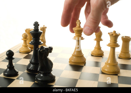 The great escape. Various chess pieces on chess board - Stock Photo