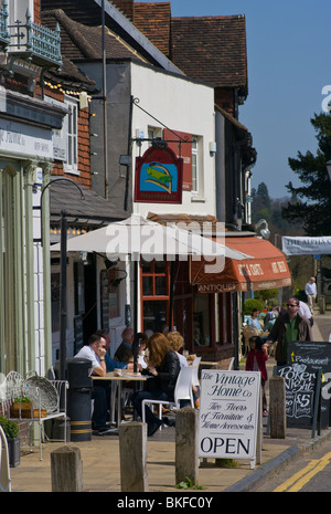 People Relaxing In The Sun at Pavement Tables Of A Cafe Westerham Kent England - Stock Photo