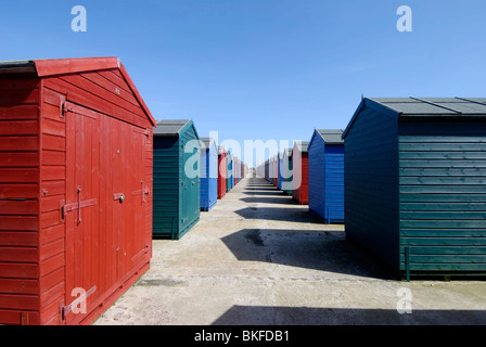 Brightly coloured beach huts on the sea front in St Leonards Hastings E. Sussex, England - Stock Photo