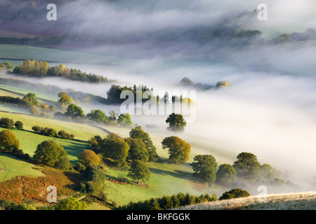 Mist covered rolling countryside in the Usk Valley, Brecon Beacons National Park, Powys, Wales, UK. Autumn (October) - Stock Photo