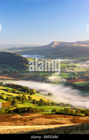 Rolling mist covered farmland in the Usk Valley, Brecon Beacons National Park, Powys, Wales, UK. Autumn (October) - Stock Photo
