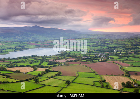 Pink sunset above the Brecon Beacons mountains and rural countryside near Llangorse, Brecon Beacons National Park, - Stock Photo