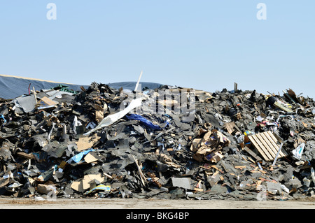 Large pile of commercial debris and trash at landfill in Bourne, Cape Cod Massachusetts usa - Stock Photo