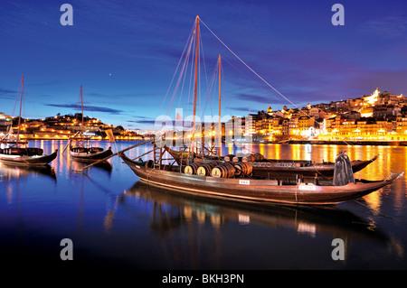 Portugal, Porto: Night view of the port wine ships at Vila Nova de Gaia at river Douro - Stock Photo