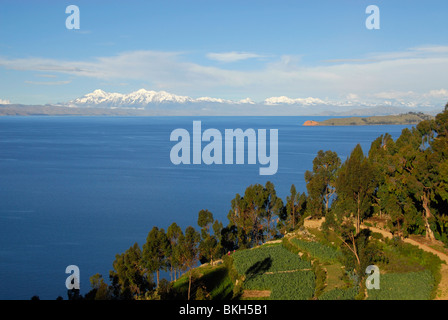 Snowy mountains as seen from Isla del Sol, Bolivia, South America - Stock Photo
