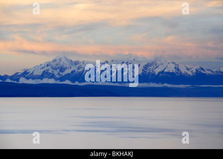 View of snow capped mountains as seen from Isla del Sol, Lake Titicaca, Bolivia, South America - Stock Photo