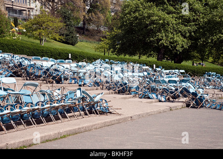 Toppled chairs in the open-air Ross Bandstand in Edinburgh's Princes Street Gardens - Stock Photo