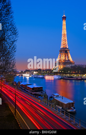 Blue Hour in Paris along the Seine on the Eiffeltower - Stock Photo