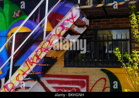 Heavily tagged staircase and graffiti on the back of a building at Keele subway station Toronto - Stock Photo