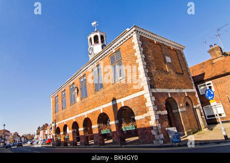 Horizontal wide angle view of the prominent red brick Market Hall in Old Amersham High Street on a sunny day. - Stock Photo