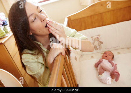 Woman alone with baby - Stock Photo