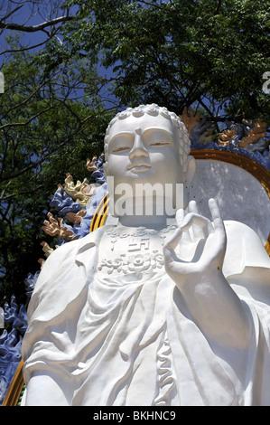 Upper section of statue of A Di Da, or Amitabha, the Buddha of the past. Ta Cu mountain, Binh Thuan Province, Vietnam - Stock Photo