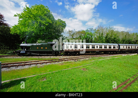 Steam train leaving Bodmin Parkway Station, Cornwall, UK - Stock Photo