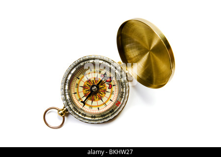 Antique brass compass on white background with soft shadow - Stock Photo