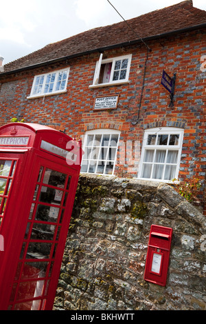 Village post office in Tillington West Sussex with old red phone box, old public telephone sign and wall mounted - Stock Photo