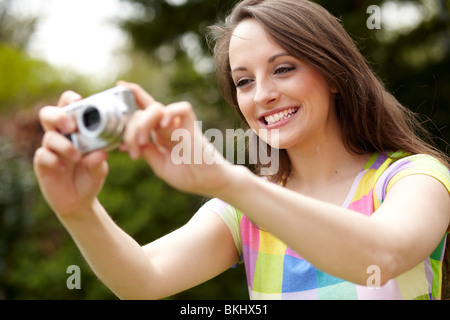 Girl with camera - Stock Photo