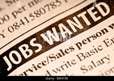 Jobs wanted. Employment classified in a newspaper. - Stock Photo