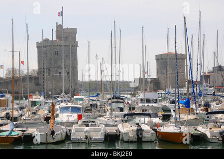 The city of LA ROCHELLE on the west coast of France. Entrance to the old harbor -  Vieux Port - Stock Photo
