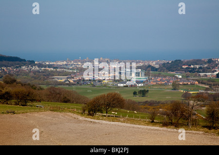 View of Aberystwyth town nestling between the surrounding hills looking west towards the sea - Stock Photo