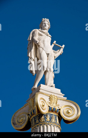 Marble statue of the ancient greek god Apollo- god of the sun and music in front of the Academy in Athens Greece - Stock Photo