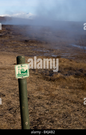 signpost at Geysir Iceland warning of hot temperatures of ground water and steam - Stock Photo