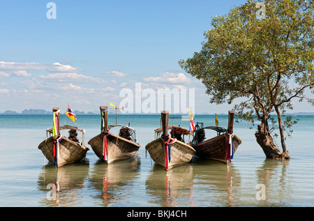 Thai longtail boats on the beach in Krabi, Southern Thailand - Stock Photo