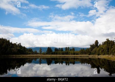 Dramatic reflections on Lake Matheson South Island New Zealand - Stock Photo