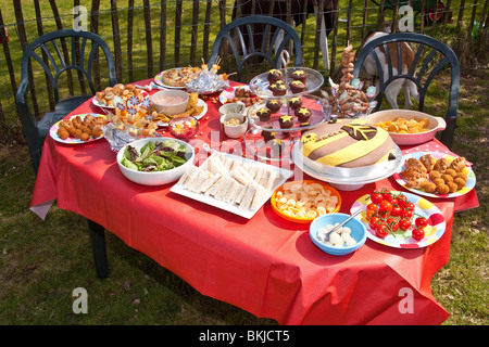 A table filled with kids party food and snacks stock photo - Kids party food table ideas ...