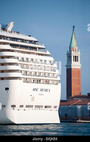 Large modern passenger cruise ship sailing into Venice Italy - Stock Photo