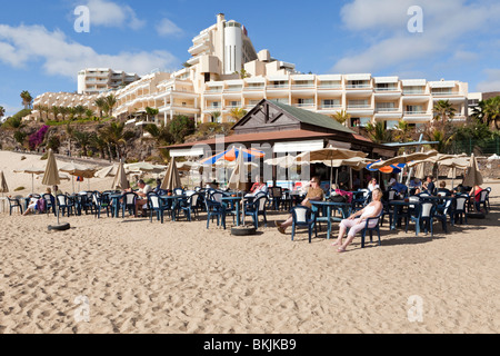 A cafe on the beach in front of the Riu Palace Hotel in the coastal resort of Jandia on the Canary Island of Fuerteventura - Stock Photo