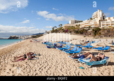 The beach in front of the Riu Palace Hotel in the coastal resort of Jandia on the Canary Island of Fuerteventura - Stock Photo