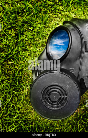 Gas mask on green grass - Stock Photo