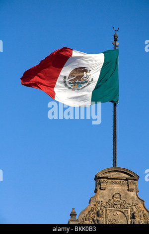 The Flag of Mexico atop the National Palace in Mexico City, Mexico. - Stock Photo