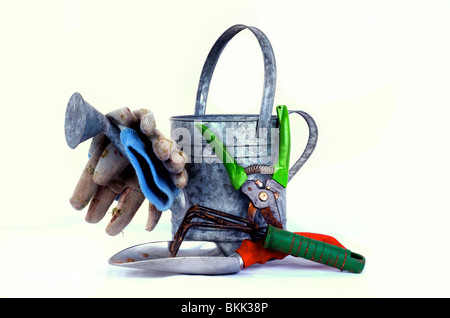 Garden tools with a watering can used in a garden on a white back ground - Stock Photo