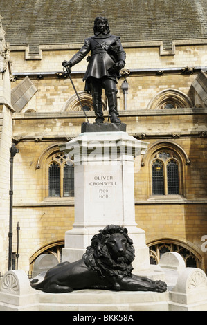 Statue of Oliver Cromwell outside the Houses of Parliament, Westminster, London, England, UK - Stock Photo