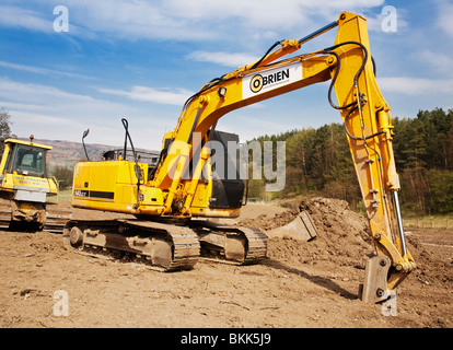 Hyundai 140LC-7 Robex Tracked Excavator with shutters over its windows on a construction site. - Stock Photo