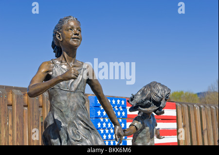 A bronze sculpture of children playing graces the 'Kids Konnection Playground', in the ski resort town of Ruidoso, New Mexico.