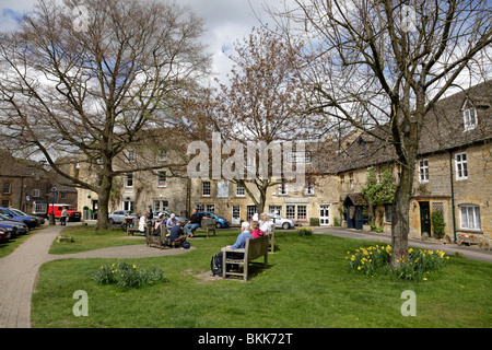 view of the green where the old stocks still stand market square stow on the wold gloucestershire uk - Stock Photo