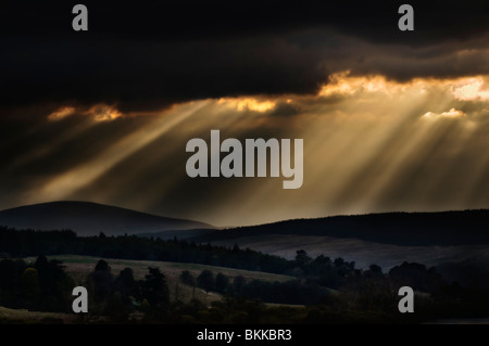 Sunrays breaking through stormy sky, taken early evening near Invershin, looking towards the Kyle of Sutherland, - Stock Photo