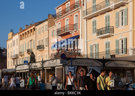 Houses, stores and bars facing the port of Saint Tropez, Cote d'Azur, Var, France - Stock Photo