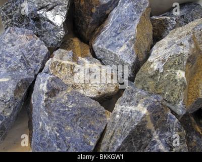 Collection of raw semi-precious stone mineral Sodalite (Sodium Aluminum Silicate Chloride) - Stock Photo