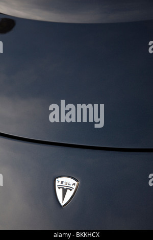 Bonnet and logo of a Tesla Roadster, a high performance electric sports car, UK - Stock Photo