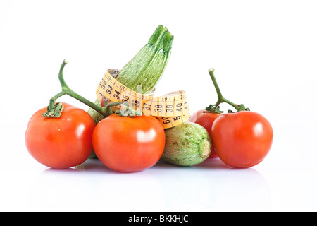 two courgettes and tomatoes with meter isolated on white background - Stock Photo