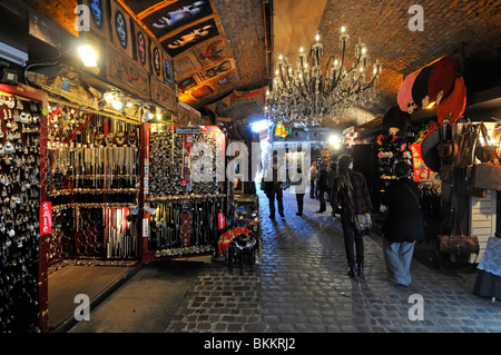 Stables Market stalls in former historical Pickfords stables buildings part of Camden Market in Camden Town London - Stock Photo
