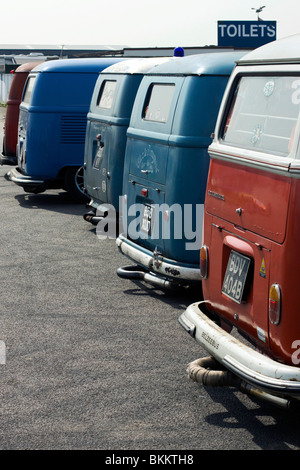 Back View of Volkswagen campers waiting for toilet at Santa Pod Raceway England - Stock Photo