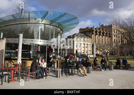 St Andrew Square Edinburgh with Coffee Republic outdoor café, customers in warm clothing sitting outdoors in March - Stock Photo