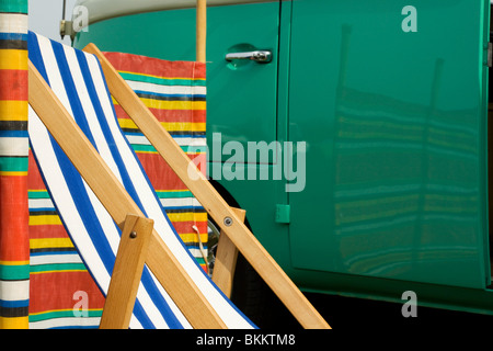 1966 side view VW Camper reflecting wind break and deck chair at the Big Bang Show Santa Pod RAceway England - Stock Photo