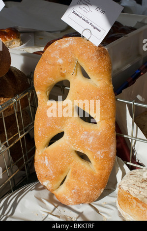 Roasted garlic fougasse bread for sale in farmers' market, Kelso, Scotland. - Stock Photo