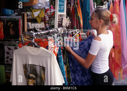 Teenage girl shopping for clothes in Greece - Stock Photo
