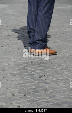 one business man commuter standing in street in city town - Stock Photo
